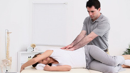 Physiotherapist massaging the back of a patient Stock Video Footage