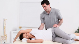 Physiotherapist massaging the back of a patient Footage