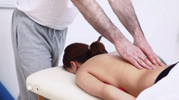 Physiotherapist Massaging The Back Of A Woman stock footage