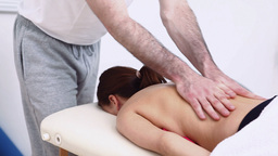 Physiotherapist massaging the back of a woman Stock Video Footage
