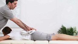Physiotherapist Massaging The Pelvis Of A Woman stock footage