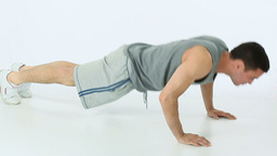 Man doing push ups and clapping Stock Video Footage