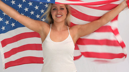 Blonde woman holding a USA flag Stock Video Footage