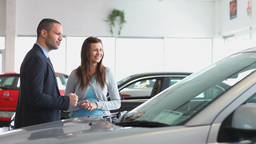 Businessman showing a car to a woman Stock Video Footage
