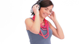 Woman dancing with her hands on her headphone Footage
