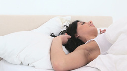 Woman turning in her bed Footage