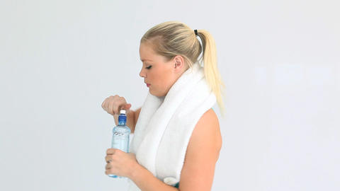 Woman drinking water after running Footage