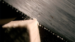 Saw cutting in super slow motion a piece of wood Footage