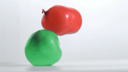 Balloons falling in super slow Stock Video Footage