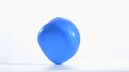Blue balloon rebounding in super slow motion Stock Video Footage