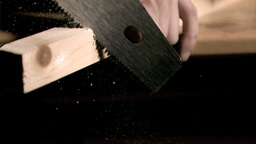 Man sawing in super slow motion a wooden board Footage