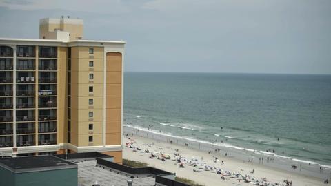 1824 People Enjoying the Beach with Ocean Waves in Footage