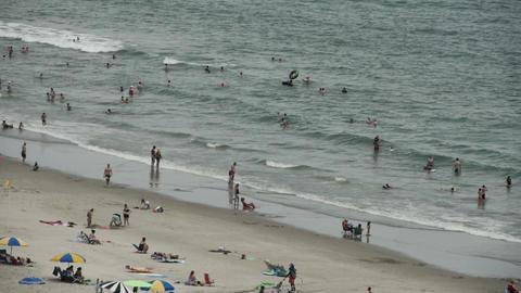 1825 People Enjoying the Beach with Ocean Waves in Footage