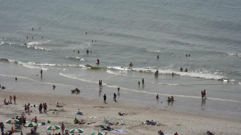 1827 People Enjoying the Beach with Ocean Waves in Footage