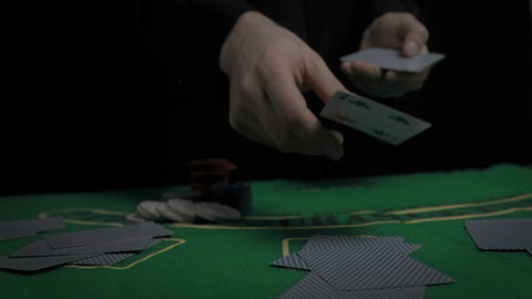 Man throwing cards on the table Stock Video Footage
