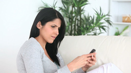 Stressed woman text messaging Footage