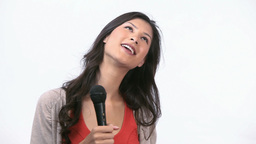 Woman holding a micro while singing Footage