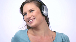 Woman wearing headphone while dancing Stock Video Footage