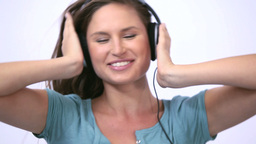 Woman wearing headphone while dancing Footage