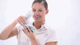 Happy woman holding banknotes Footage