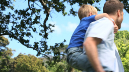 Father playing with his son on his shoulders Stock Video Footage