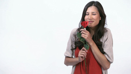 Smiling woman holding a rose Stock Video Footage
