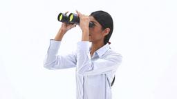 Woman holding binoculars Footage