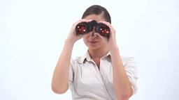Classy woman holding binoculars Stock Video Footage