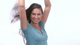 Smiling woman raising arms Stock Video Footage