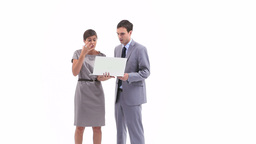 Business people holding a laptop while talking Stock Video Footage