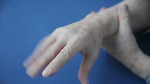 Hand numbness in senior man Stock Video Footage