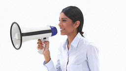 Woman talking into a megaphone Stock Video Footage