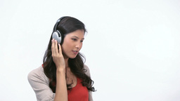 Woman listening while dancing Stock Video Footage