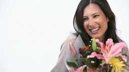 Joyful woman receiving a bunch of flower Footage