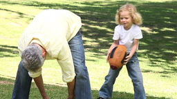 Man playing with a boy in a park Footage
