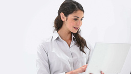 Smiling woman using a laptop Stock Video Footage