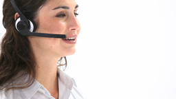Elegant woman talking into a headset Stock Video Footage