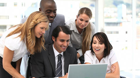Business team looking at a laptop Stock Video Footage