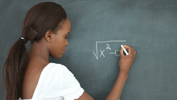 Video of a student writing on a blackboard Stock Video Footage