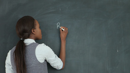 Video of a teacher drawing a chart on a blackboard Stock Video Footage