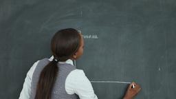 Video of a teacher drawing a chart on a blackboard Footage