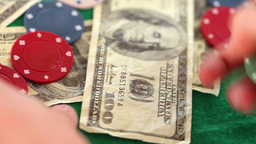 Gambling coins and dollar bills spinning Footage