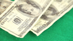 Coins and dollar spinning on a gambling table Footage