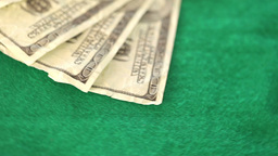 Gambling coins and dollar thrown on a gambling table Stock Video Footage