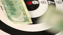 Dollar bills thrown on a spinning target Footage