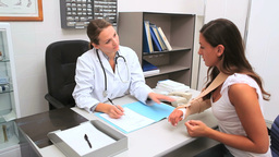 Doctor giving a paper Stock Video Footage
