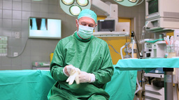 Surgeon putting on surgical gloves Footage