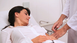 Doctor doing an injection to a patient Stock Video Footage