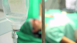 Focus on an intravenous drip next to a patient Stock Video Footage