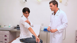 Doctor shaking hand of a patient and preparing an injection Footage